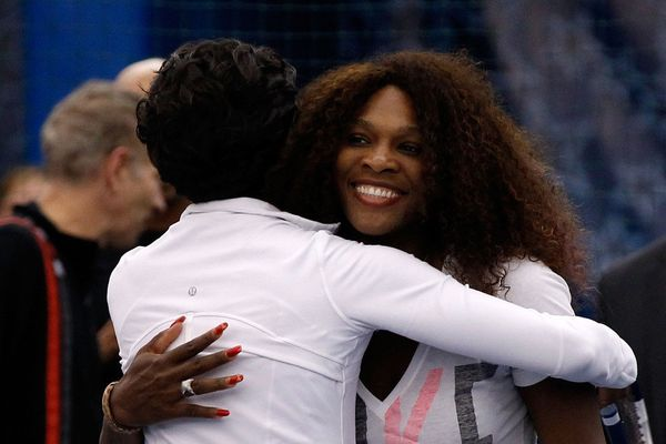 Michelle and professional tennis player Serena Williams share a hug during the 2011 U.S. Open. Here are two ladies we would <
