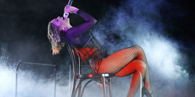 LOS ANGELES, CA - JANUARY 26: Beyonce Knowles performs onstage during the 56th GRAMMY Awards held at Staples Center on January 26, 2014 in Los Angeles, California. (Photo by Michael Tran/FilmMagic)