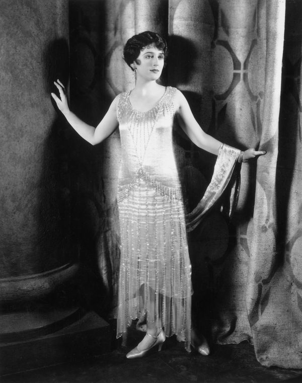 "Flappers were known for their bobbed hair, shortened dresses and ""scandalous"" behavior such as smoking in public and driving"