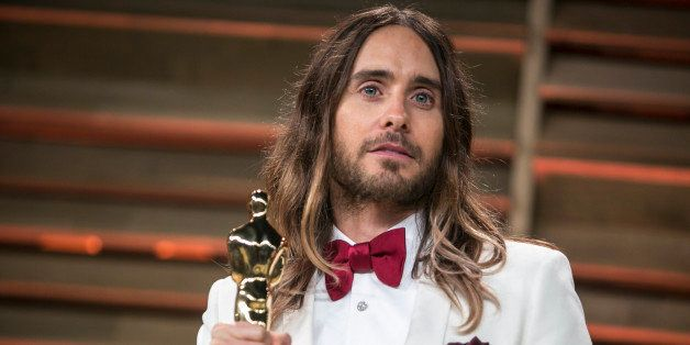 Jared Leto with his Academy Award for best supporting actor in Dallas Buyers Club arrives to the 2014 Vanity Fair Oscar Party