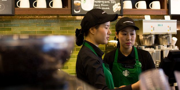 Barista Kim Jung Mi, a mother who had left the workforce seven years ago and is now employed by Starbucks Coffee Korea Co. un