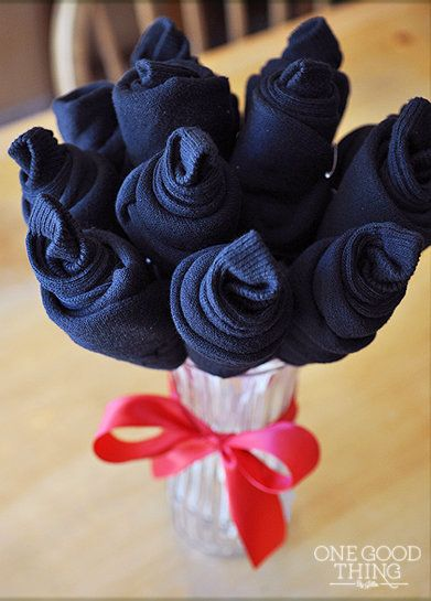 Talk about a gift that knocks your socks off -- roll and pin cozy new socks, stick them on skewers and assemble in a vase. Vo