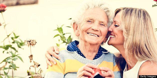 Happy elderly lady knitting