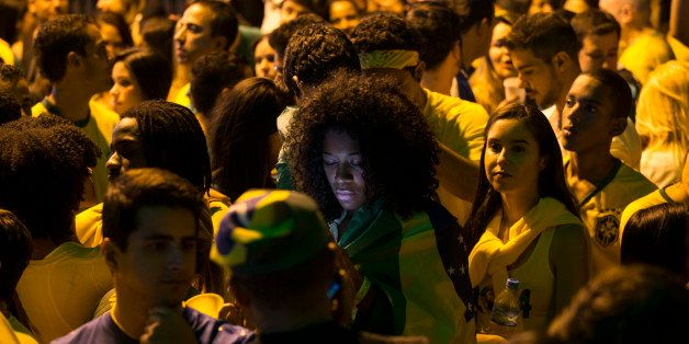 BELO HORIZONTE, BRAZIL - JUNE 23:  A fan of the Brazilian football team checks her phone at half-time in their match against