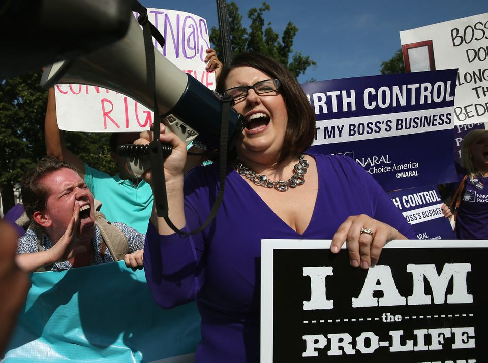 WASHINGTON, DC - JUNE 30: Protesters from both sides of the birth control issue Leah Hughs (L) and Kristin Hughs (R) chant fo