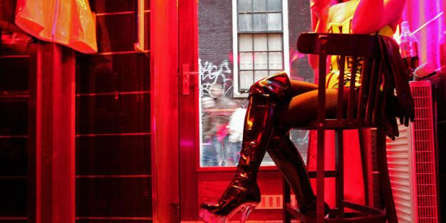 TO GO WITH AFP STORY BY ALIX RIJCKAERT A German prostitute, called Eve, waits for clients behind her window in the red light