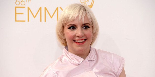Lena Dunham arrives at the 66th Primetime Emmy Awards at the Nokia Theatre L.A. Live on Monday, Aug. 25, 2014, in Los Angeles
