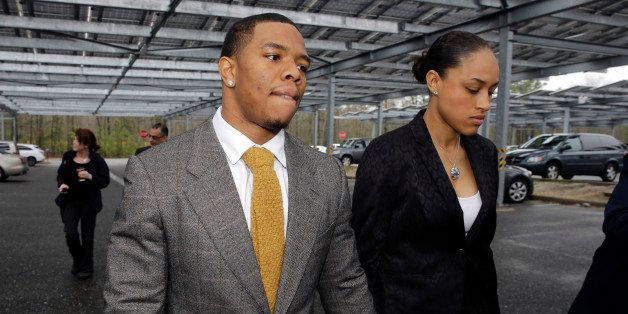 FILE - In this May 1, 2014, file photo, Baltimore Ravens football player  Ray Rice holds hands with his wife, Janay Palmer, a