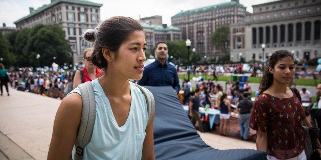 NEW YORK, NY - SEPTEMBER 05:  Emma Sulkowicz (L),  a senior visual arts student at Columbia University, carries a mattress, w