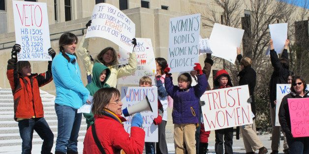 FILE - In this March 25, 2013, file photo Kris Kitko, left, leads chants of protest at an abortion-rights rally at the state