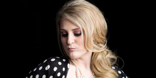 """American singer, songwriter and record producer known for the pop single """"All About That Bass"""" Meghan Trainor poses for a por"""