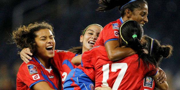 From left to right, Costa Rica's Raquel Rodriguez, Wendy Acosta, Diana Saenz, and Melissa Herrera (17) congratulate Carolina
