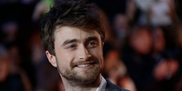 Actor Daniel Radcliffe poses for photographers upon arrival at the premiere of the film Horns, in central London, Monday, Oct