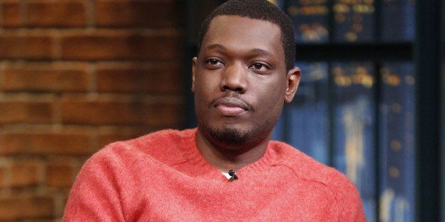 LATE NIGHT WITH SETH MEYERS -- Episode 104 -- Pictured: Comedian Michael Che during an interview on September 29, 2014 -- (Ph