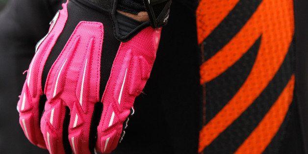 CINCINNATI, OH - OCTOBER 07:  Michael Johnson #93 of the Cincinnati Bengals, wears pink gloves for breast cancer awareness du