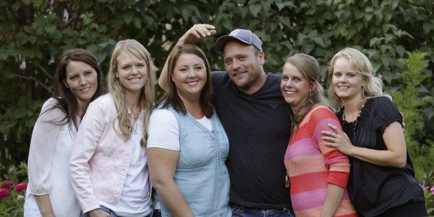 FILE - In this Sept. 11, 2013, file photo, Brady Williams poses with his wives, from left to right, Paulie, Robyn, Rosemary,