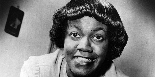 """American writer Gwendolyn Brooks, of Chicago, Ill., poses with her first book of poems titled """"A Street in Bronzeville,"""" 1945"""