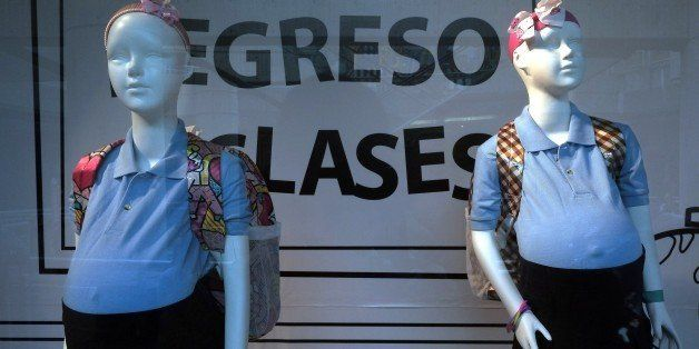 Mannequins of pregnant girls are displayed at a mall's window shop to increase public awareness of early pregnancy, in Caraca