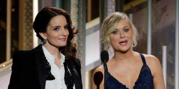 BEVERLY HILLS, CA - JANUARY 11:  In this handout photo provided by NBCUniversal, Hosts Tina Fey and Amy Poehler speak onstage