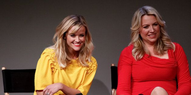 NEW YORK, NY - DECEMBER 03:  Actress Reese Witherspoon (L) and author Cheryl Strayed attend Apple Store Soho Presents : Meet