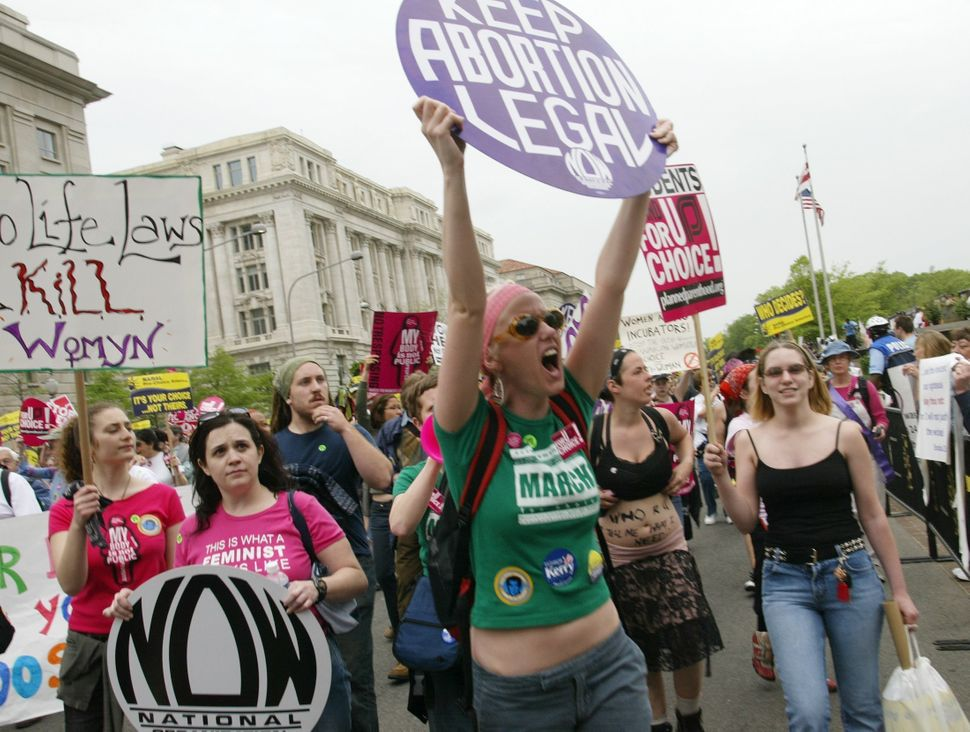 <strong>2004:</strong> Tina Welke, 28, of Minneapolis, Minnesota, joins thousands of fellow protesters as they parade down Pe