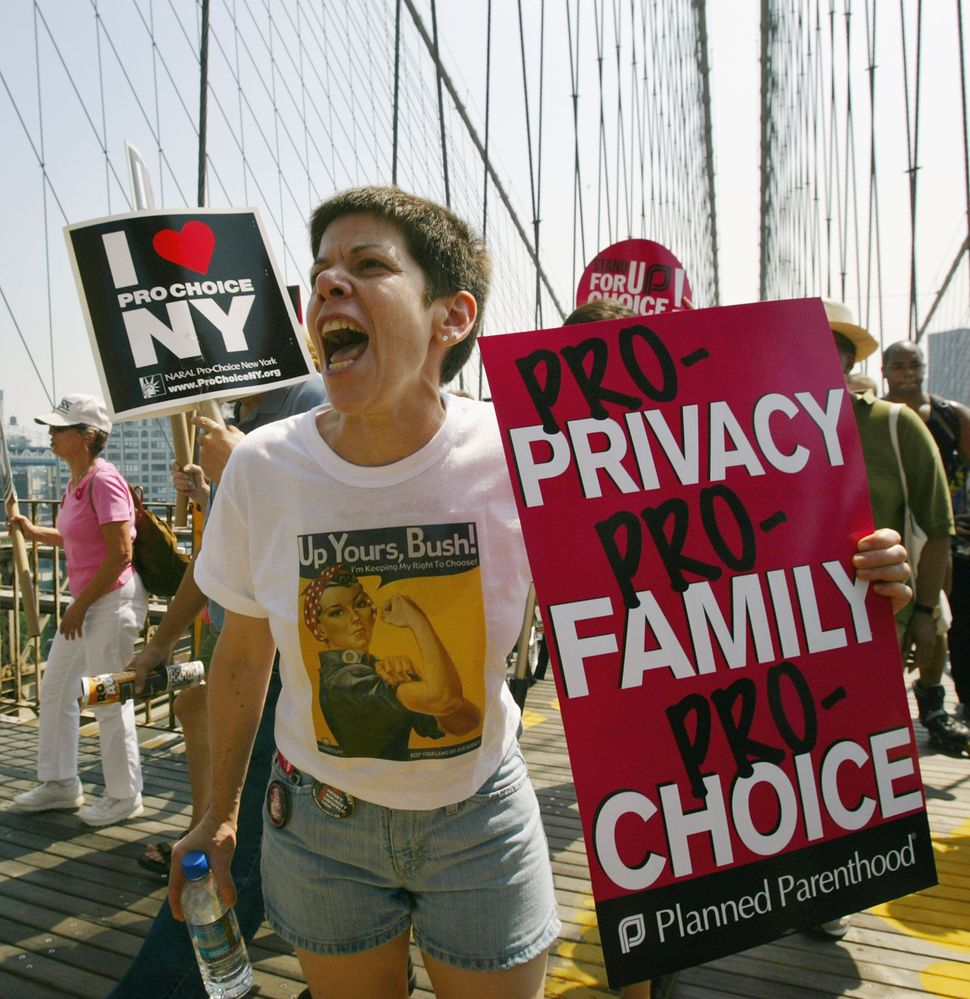 <strong>2004:</strong> Protestors march across the Brooklyn Bridge in support of a women's right to choose August 28, 2004 in