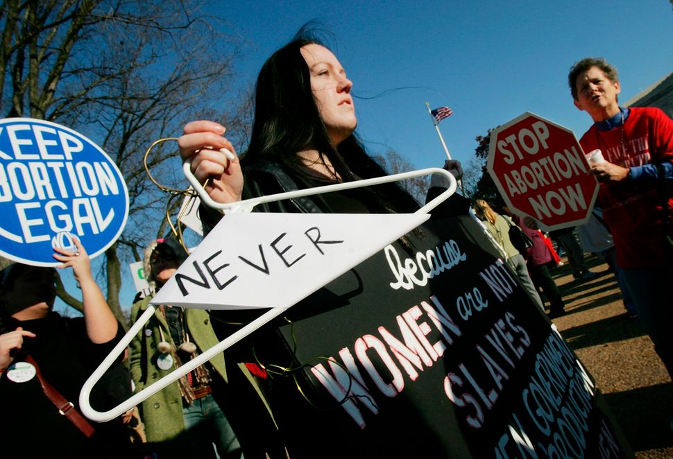 <strong>2005:</strong> Pro-abortion rights activists and anti-abortion activists demonstrate in front of the U.S. Supreme Cou