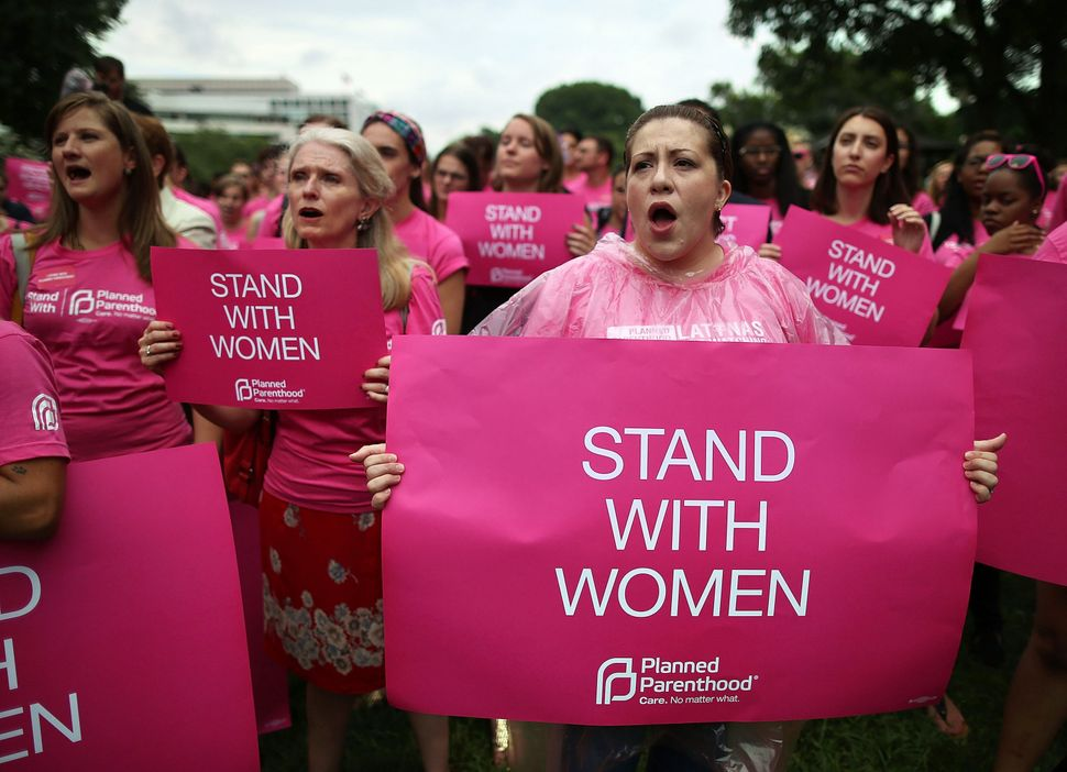 <strong>2013: </strong>Women hold up signs during a women's pro-abortion rights rally on Capitol Hill, July 11, 2013 in Washi