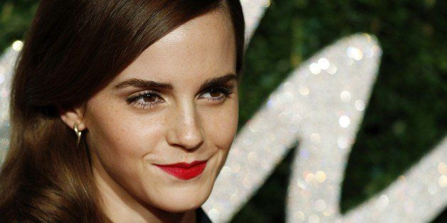 English actress Emma Watson poses for pictures on the red carpet upon arrival to attend the British Fashion Awards 2014 in Lo