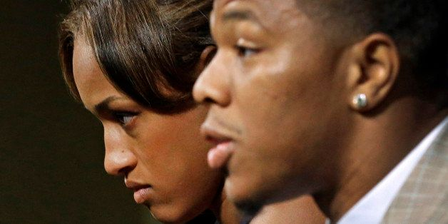 FILE - In this May 23, 2014, file photo, Janay Rice, left, looks on as her husband, Baltimore Ravens running back Ray Rice, s