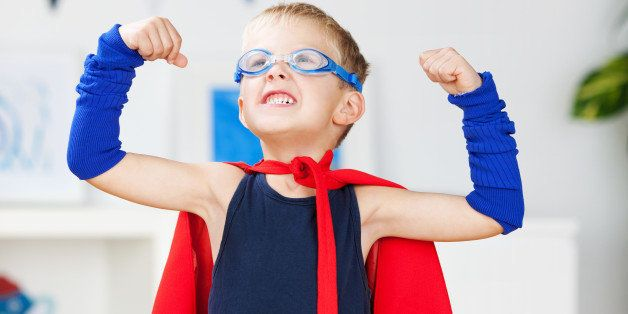 strong kid wearing a superhero...