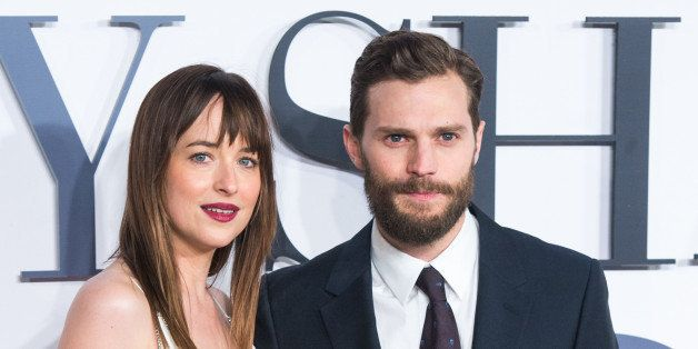 LONDON, ENGLAND - FEBRUARY 12:  Jamie Dornan and Dakota Johnson attend the UK Premiere of 'Fifty Shades Of Grey' at Odeon Lei