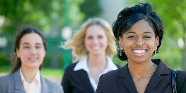 Three businesswomen smiling