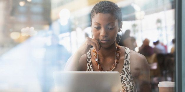 African American woman using laptop in