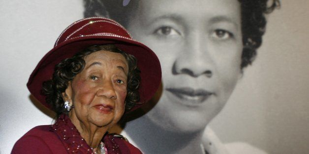 """FILE -- In a Feb. 14, 2008 file photo Dorothy Irene Height  sits in front of her portrait inside the """"Freedom's Sisters"""" exhi"""