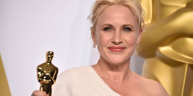 "Patricia Arquette poses in the press room with the award for best actress in a supporting role for ""Boyhood"" at the Oscar"