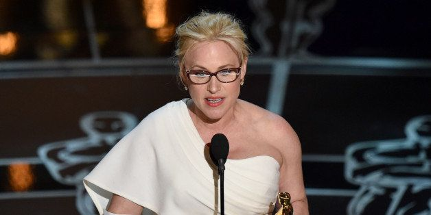 """Patricia Arquette accepts the award for best actress in a supporting role for """"Boyhood"""" at the Oscars on Sunday, Feb. 22,"""