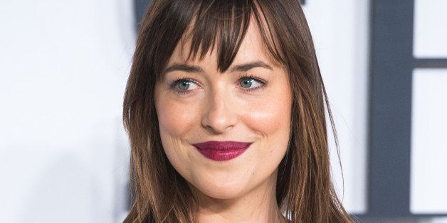LONDON, ENGLAND - FEBRUARY 12:  Dakota Johnson attends the UK Premiere of 'Fifty Shades Of Grey' at Odeon Leicester Square on