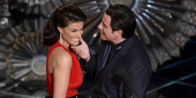 Idina Menzel, left, and John Travolta present the award for best original song at the Oscars on Sunday, Feb. 22, 2015, at the
