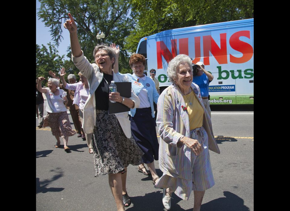 "Sister Diane Donoghue, right, and Sister Simone Campbell, left, lead the way as the the ""Nuns on the Bus"" arrive on Capitol H"