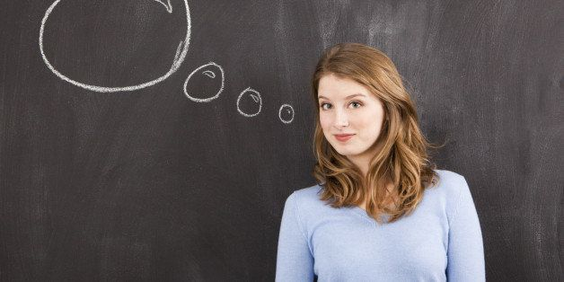 Studio portrait of woman with chalk thought bubble