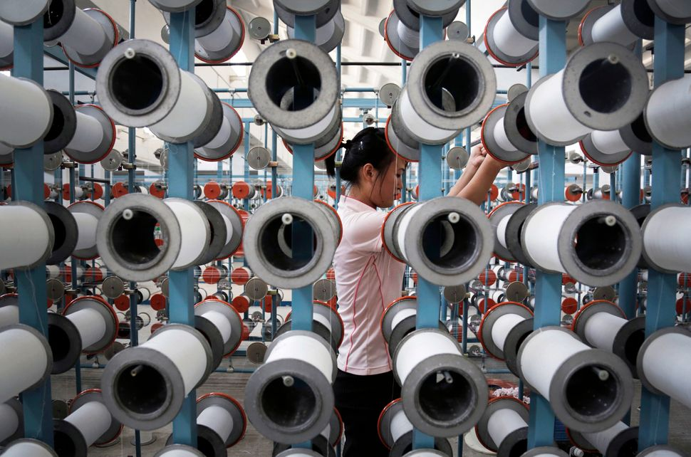 A North Korean woman works at the Kim Jong Suk Pyongyang textile factory, Thursday, July 31, 2014, in Pyongyang, North Korea.
