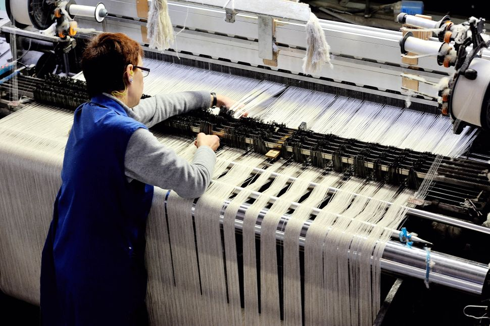 An employee of the Lemaitre Demeestere company works with a linen loom on April 16, 2013 in Halluin, northern France. (PHILIP