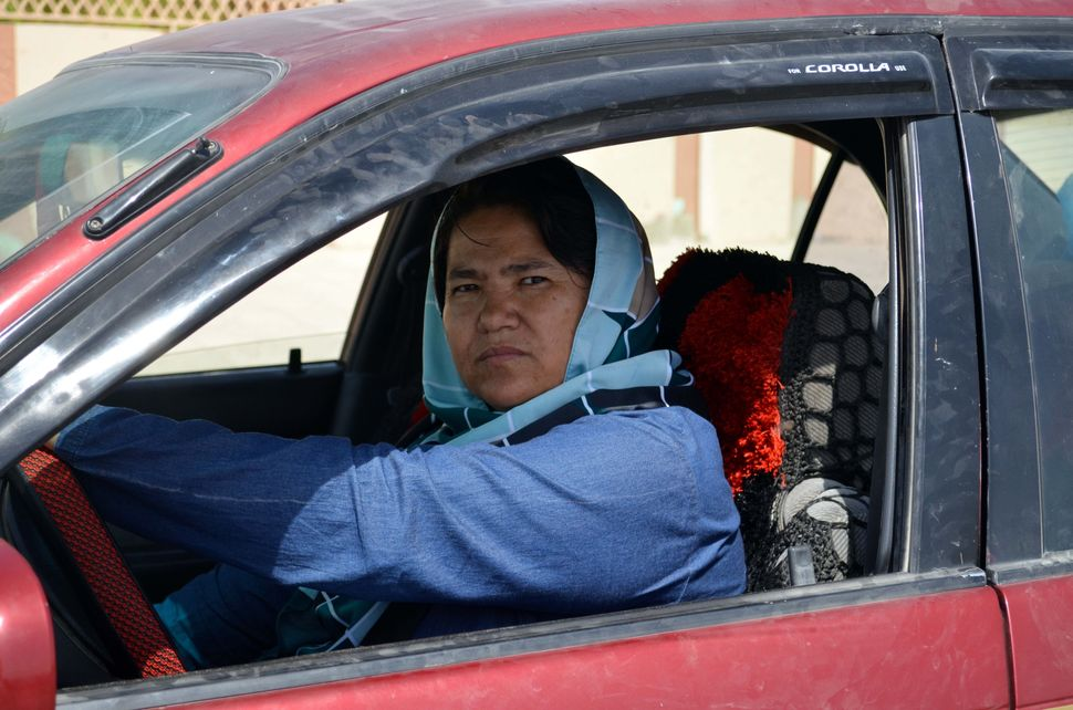 First woman taxi driver of Afghanistan Sara Bahai works for the women who aren't allowed to use taxis without their first deg