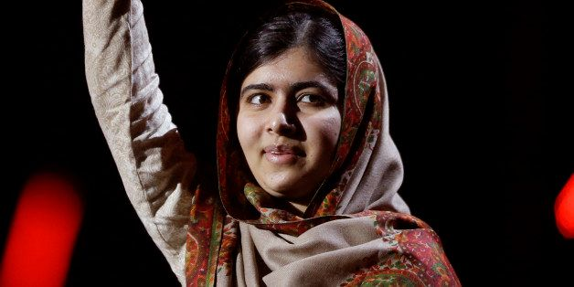 Joint-Nobel Peace Prize winner Malala Yousafzai from Pakistan waves as she arrives to speak on stage during the Nobel Peace P