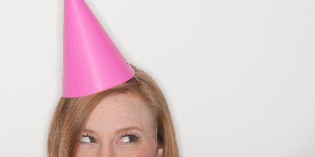 Studio shot of woman wearing pink party hat
