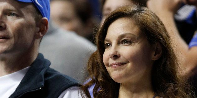 Actress Ashley Judd watches an NCAA college basketball game between Florida and Kentucky, Saturday, March 7, 2015, in Lexingt