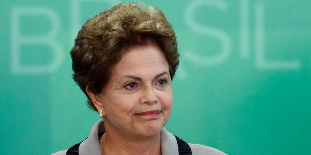 Brazil's President Dilma Rousseff smiles as she arrives for a government ceremony at the Planalto presidential palace in Bras