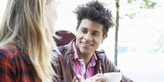 young man and woman talking in cafe