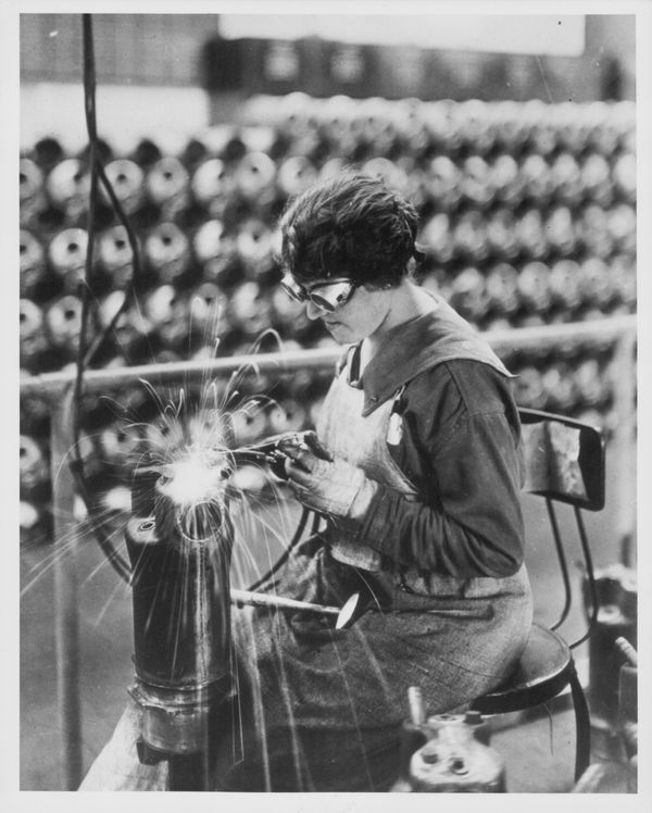 A woman working in a munitions factory during World War One, aiding the war effort whilst the men are away, USA, circa 1914-1